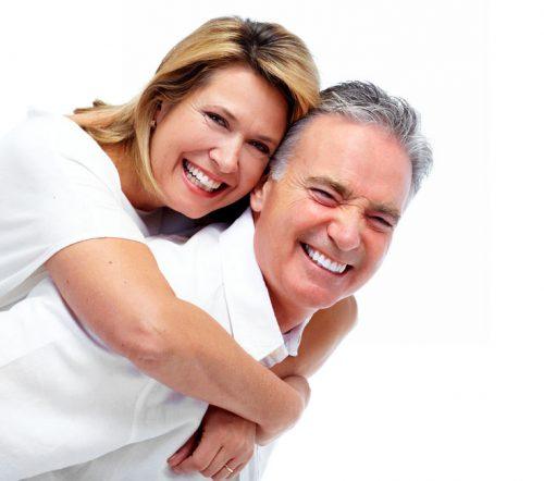 46515627 - happy laughing elderly couple isolated white background.